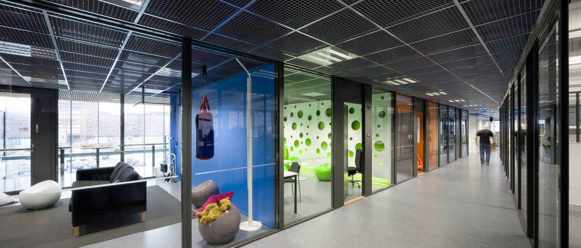 Full height glass partitions and open cell ceiling